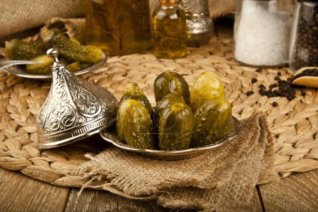 Pickled Cucumbers with wooden background
