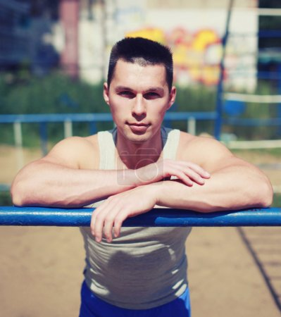 Street workout, portrait sporty man relaxing after training outd