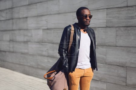Street fashion concept - stylish handsome african man standing i