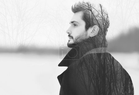 Photo for Double exposure of handsome elegant bearded man in profile pensive looks into the distance, black and white photo - Royalty Free Image