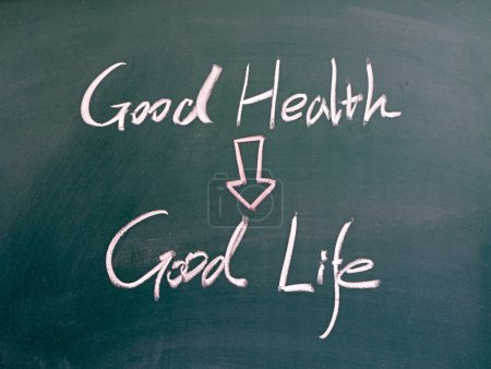 Photo for Good health and good life words written on blackboard - Royalty Free Image