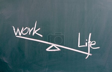 Life and work balance concept on blackboard
