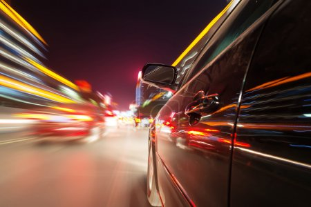 Photo for Car on road at night with motion blur background - Royalty Free Image
