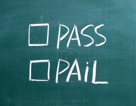 Tick boxes for Pass or Fail on a wiped blackboard