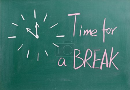 Time for a break sign on blackboard