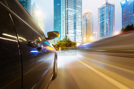 Car driving through city