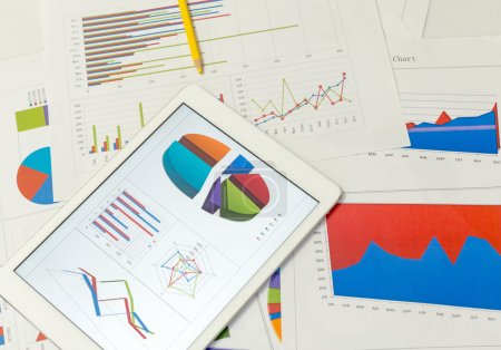 Financial charts with tablet