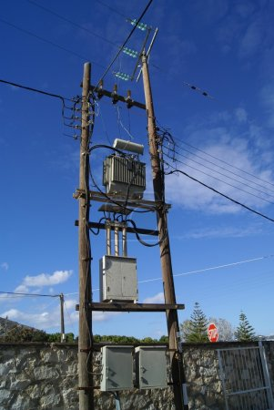 A column or post used to support overhead power li...