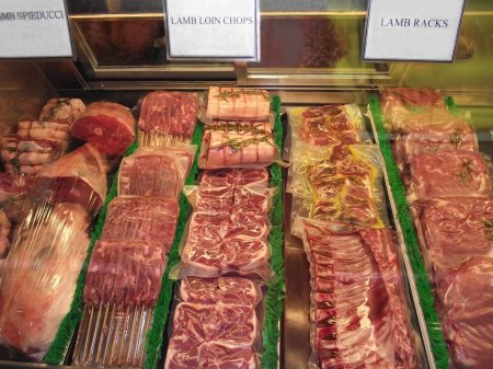 Display of meat in a fridge of a butcher shop, store, or market