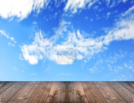 Bright blur blue sky with wooden floor