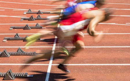 Photo for Sprint start in track and field in blurred motion - Royalty Free Image