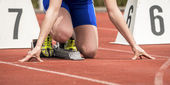 Woaman in sprintstart in track and field