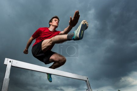 Photo for Hurdling in track and field - Royalty Free Image