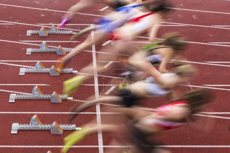 Photo for Sprint start in track and field in blured motion - Royalty Free Image