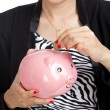 Постер, плакат: Asian business woman with coin and pig coin bank