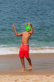 Brazilian kid juggling with football, Copacabana, Rio de Janeiro