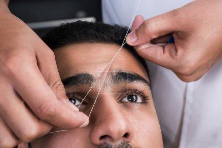 Facial hair removal eyebrows threading procedure i...