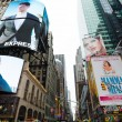 Times square on midday where you can see large cro...