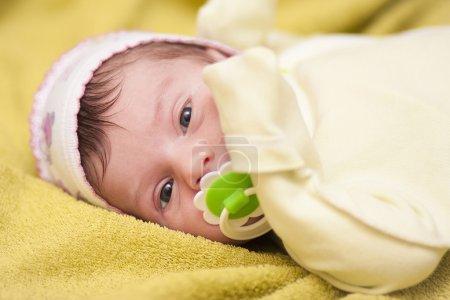 Newborn baby lying