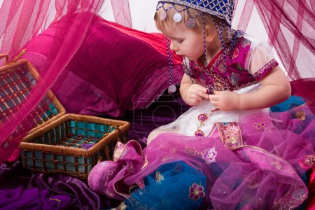 Little young east girl, sultana, Princess in Indian dress sari b
