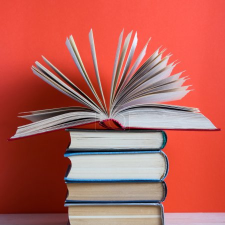 Back to school, vintage old hardback books, diary with fanned pages