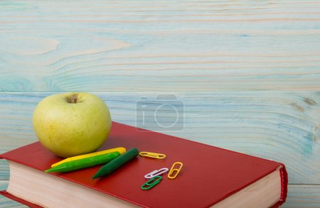 Back to school. Stack of colorful books on wooden table. Copy sp
