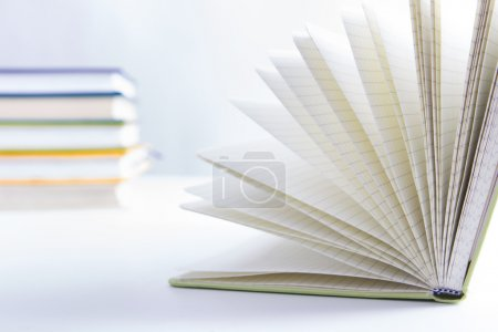 A stack of colorful books, open book. Back to school