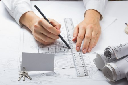 Architect working on blueprint. Architects workplace - architectural project, blueprints, ruler, calculator. Construction REAL ESTATE concept. Engineering tools. Top view.