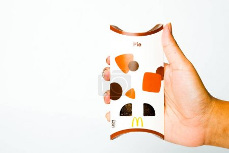 A picture of hand holding new McDonald Chocolate p...