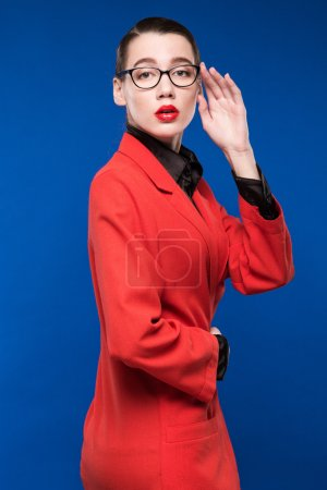 woman in a red jacket with lipstick