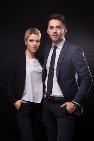 stylish, trendy and modern business man and woman on black backg