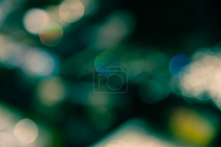 Abstract blur bokeh defocused of light in city  green yellow spl
