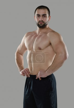 Photo for Great workout. Portrait of muscular professional bodybuilder and fitness trainer. Muscular male sportsman is training himself. Gym fitness sport muscle concept. - Royalty Free Image