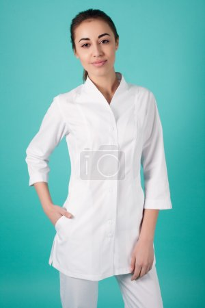 Smiling medical woman doctor  Isolated over turquoise background