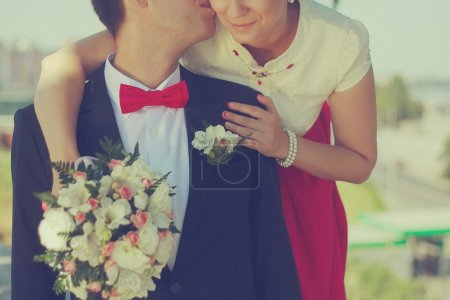 Photo for Bride hold groom by the hand and wedding bouquet. Focus on wedding flower bouquet. Crop by chest and legs. Bride in wedding dress, groom wears classic clothes. Vintage style coloring love - Royalty Free Image
