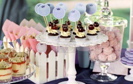 Delicious sweet buffet with cupcakes, tiramisu gla...