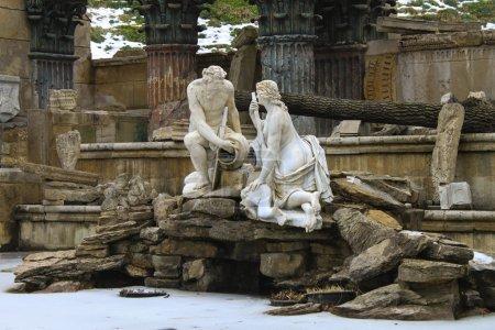Roman man and woman among the icy pond.