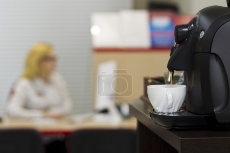 Coffee machine in the office interior