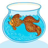 Goldfish and patterned tail floats in the aquarium