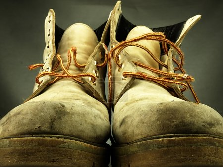 Pair of old, worn heavy boots.