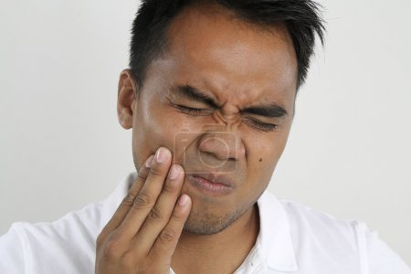 suffering man with teeth problems