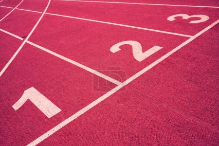 Photo for Numbered lanes on a running track. - Royalty Free Image
