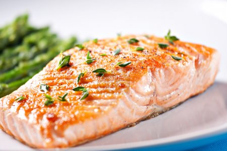 Photo for Fillet of salmon with asparagus, close-up - Royalty Free Image