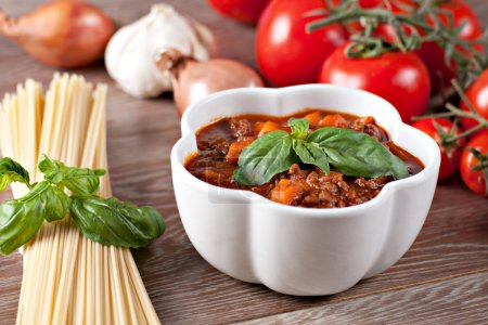 Photo for Bolognese sauce on wooden table, close-up - Royalty Free Image