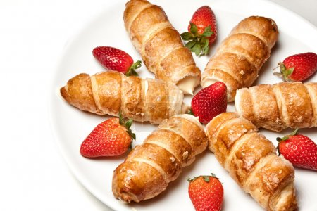 Strawberries and puff pastry rolls