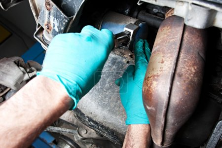 Mechanic replacing the oil filter