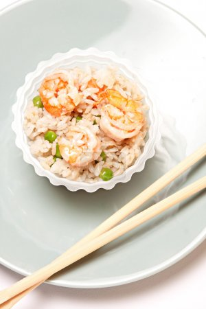 Photo for Chinese rice with shrimps and mushrooms on white plate - Royalty Free Image