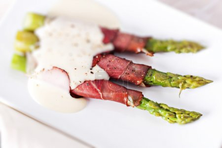 Photo for Ham rolls with asparagus and bechamel - Royalty Free Image