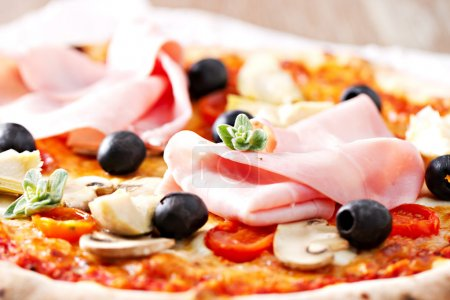 Pizza with olives, ham