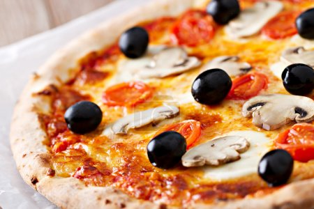Pizza with olives and mushrooms